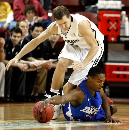 Dayton's Dyshawn Pierre, bottom, reaches for the ball against Colorado's Eli Stalzer during the second half of an NCAA college basketball game at the Charleston Classic at TD Arena, Thursday Nov. 15, 2012, in Charleston, S.C.   (AP Photo/Mic Smith)