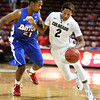 Colorado's Xavier Johnson, right, drives the ball around Dayton's Dyshawn Pierre, left, during the first half of an NCAA college basketball game at the Charleston Classic at TD Arena, Thursday Nov. 15, 2012, in Charleston, S.C.   (AP Photo/Mic Smith)