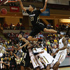 Colorado's Andre Roberson, top, drives to the basket past Murray State during an NCAA college basketball game at the Charleston Classic at the TD Arena, Sunday Nov. 18, 2012, in Charleston, S.C. Colorado won 81-74. (AP Photo/Alice Keeney)