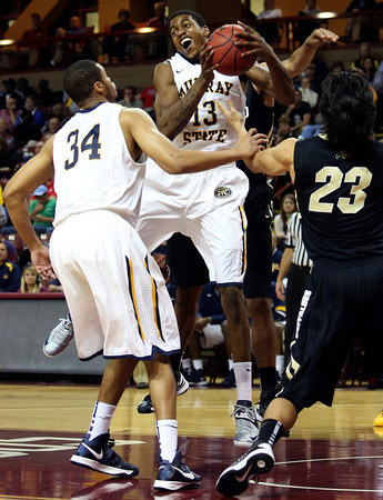 Murray State's Brandon Garrett, center, rebounds the ball during the first half of an NCAA college basketball game against Colorado at the Charleston Classic at TD Arena, Sunday Nov. 18, 2012, in Charleston, S.C. (AP Photo/Alice Keeney)