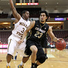 Colorado's Sabatino Chen,right, drives to the basket past Murray State's Isaiah Cannan, left, during an NCAA college basketball game at the Charleston Classic at the TD Arena, Sunday Nov. 18, 2012, in Charleston, S.C. Colorado won 81-74. (AP Photo/Alice Keeney)