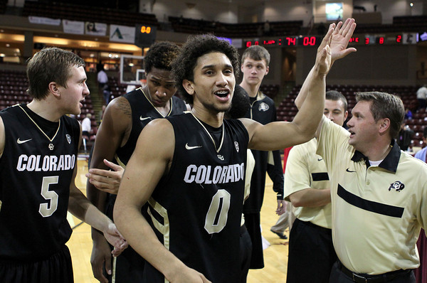 Colorado's Askia Booker (0) celebrates their win over Murray State after an NCAA college basketball game at the Charleston Classic, Sunday Nov. 18, 2012, in Charleston, S.C. Colorado won 81-74 and Booker was named tournament MVP. (AP Photo/Alice Keeney)