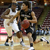 Colorado's Askia Booker drives to the basket past the Murray State defense during an NCAA college basketball game at the Charleston Classic, Sunday Nov. 18, 2012, in Charleston, S.C. Colorado won 81-74 and Booker was named tournament MVP. (AP Photo/Alice Keeney)