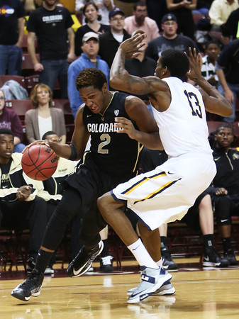 Colorado's Xavier Johnson, left, drives to the basket past Murray State's Brandon Garrett during an NCAA college basketball game at the Charleston Classic, Sunday Nov. 18, 2012, in Charleston, S.C. Colorado won 81-74. (AP Photo/Alice Keeney)