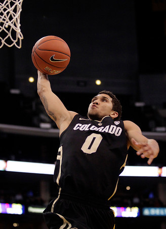 Colorado's Askia Booker goes up for a basket during the first half of an NCAA college basketball game against Oregon at the Pac-12 conference championship in Los Angeles, Thursday, March 8, 2012. (AP Photo/Jae C. Hong)