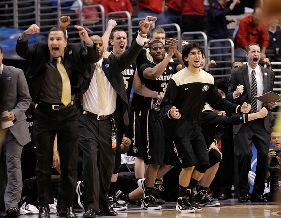 Colorado's bench celebrates the team's 63-62 win over Oregon after an NCAA college basketball game at the Pac-12 conference championship in Los Angeles, Thursday, March 8, 2012. (AP Photo/Jae C. Hong)