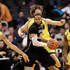 Colorado's Carlon Brown(30) is pressured by Oregon's Devoe Joseph(34), Olu Ashaolu(5) and E.J. Singler during the second half of an NCAA college basketball game at the Pac-12 conference championship in Los Angeles, Thursday, March 8, 2012. Colorado won 63-62. (AP Photo/Jae C. Hong)