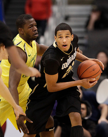 Oregon's Olu Ashaolu, left, pressures Colorado's Andre Roberson during the second half of an NCAA college basketball game at the Pac-12 conference championship in Los Angeles, Thursday, March 8, 2012. Colorado won 63-62. (AP Photo/Jae C. Hong)
