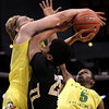 Colorado's Spencer Dinwiddie, center, gets his shot blocked by Oregon's E.J. Singler during the first half of an NCAA college basketball game at the Pac-12 conference championship in Los Angeles, Thursday, March 8, 2012. (AP Photo/Jae C. Hong)