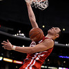 Utah's Jason Washburn dunks during the second half of an NCAA college basketball game against Colorado at the Pac-12 conference championship in Los Angeles, Wednesday, March 7, 2012. Colorado won 53-41. (AP Photo/Jae C. Hong)