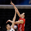 Utah's Jason Washburn, right, shoots over Colorado's Austin Dufault during the first half of an NCAA college basketball game at the Pac-12 men's tournament in Los Angeles, Wednesday, March 7, 2012. (AP Photo/Jae C. Hong)