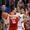 Utah's Alex Mortensen, left, looks to pass as he is defended by Colorado's Askia Booker during the first half of an NCAA college basketball game at the Pac-12 conference championship in Los Angeles, Wednesday, March 7, 2012. (AP Photo/Jae C. Hong)