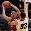 Utah's Jason Washburn, left, is defended by Colorado's Austin Dufault during the second half of an NCAA college basketball game at the Pac-12 conference championship in Los Angeles, Wednesday, March 7, 2012. Colorado won 53-41. (AP Photo/Jae C. Hong)