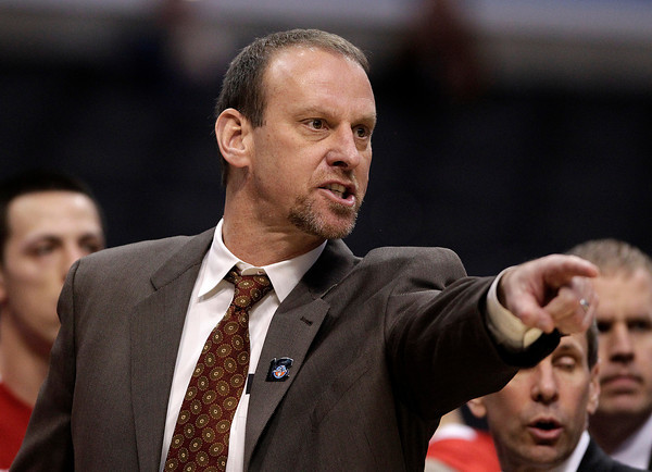 Utah head coach Larry Krystkowiak points to a referee after a technical foul call on him during the second half of an NCAA college basketball game against Colorado at the Pac-12 conference championship in Los Angeles, Wednesday, March 7, 2012. Colorado won 53-41. (AP Photo/Jae C. Hong)