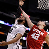 Colorado's Carlon Brown, left, puts up a shot as Utah's Jason Washburn defends during the first half of an NCAA college basketball game at the Pac-12 conference tournament in Los Angeles, Wednesday, March 7, 2012. (AP Photo/Jae C. Hong)