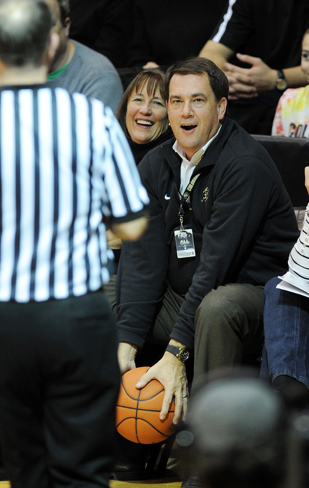 CU AD, Mike Bohn, get the pass out of bounds during the second half of the December 21, 2012 game in Boulder.<br /> Cliff Grassmick / December 21, 2012