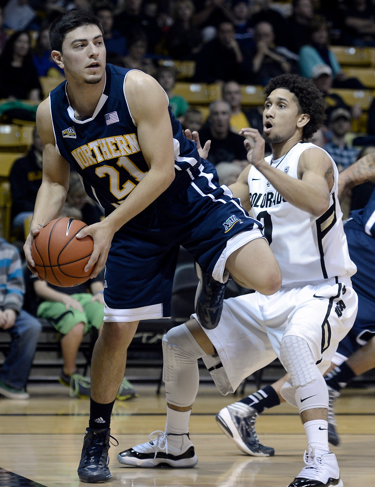"University of Colorado's Askia Booker plays tight defense on Stallon Saldivar during a game against Northern Arizona on Friday, Dec. 21, at the Coors Event Center on the CU campus in Boulder. For more photos of the game go to  <a href=""http://www.dailycamera.com"">http://www.dailycamera.com</a><br /> Jeremy Papasso/ Camera"