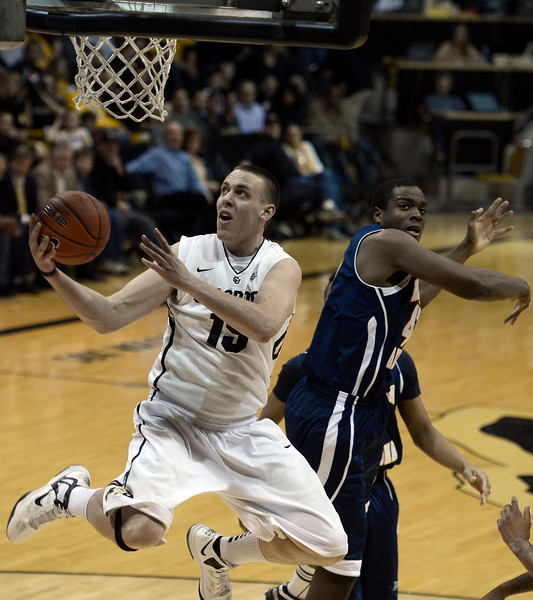 "University of Colorado's Shane Harris-Tunks goes for a layup over Ephraim Ekanem during a game against Northern Arizona on Friday, Dec. 21, at the Coors Event Center on the CU campus in Boulder. For more photos of the game go to  <a href=""http://www.dailycamera.com"">http://www.dailycamera.com</a><br /> Jeremy Papasso/ Camera"