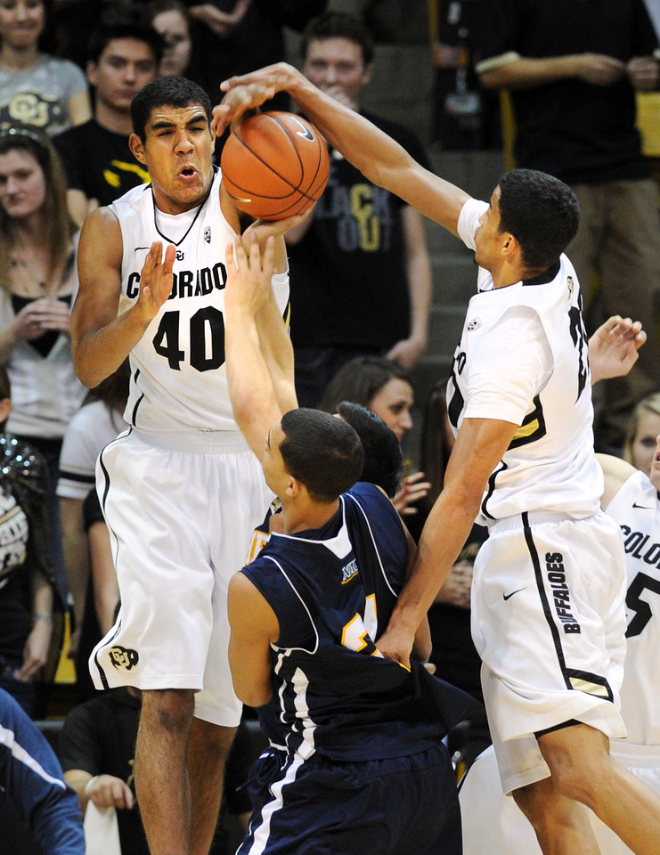 Josh Scott (40) and Andre Roberson, both of CU, put the hammer down on Stallon Saldivar of NAU during the second half of the December 21, 2012 game in Boulder.<br /> Cliff Grassmick / December 21, 2012