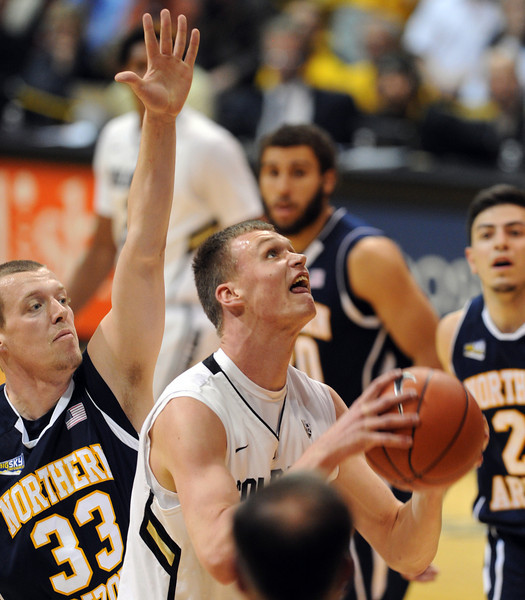 Ben Mills  of CU looks to score on Max Jacobsen of NAU during the second half of the December 21, 2012 game in Boulder.<br /> Cliff Grassmick / December 21, 2012
