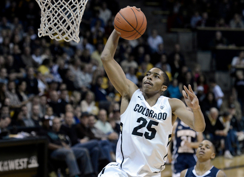 "University of Colorado's Spencer Dinwiddie dunks the ball after a breakaway during a game against Northern Arizona on Friday, Dec. 21, at the Coors Event Center on the CU campus in Boulder. For more photos of the game go to  <a href=""http://www.dailycamera.com"">http://www.dailycamera.com</a><br /> Jeremy Papasso/ Camera"