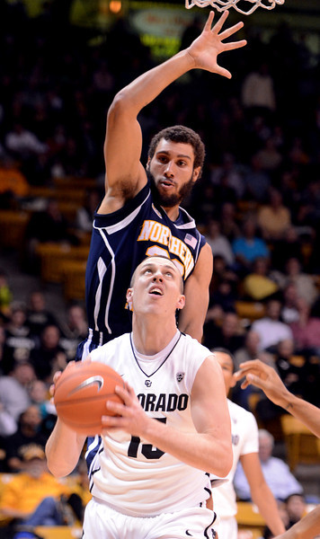 Shane Harris-Tunks of Colorado goes up on Gaellan Bewernick of Noerthern Arizona during the first half of the December 21, 2012 game in Boulder.<br /> Cliff Grassmick / December 21, 2012