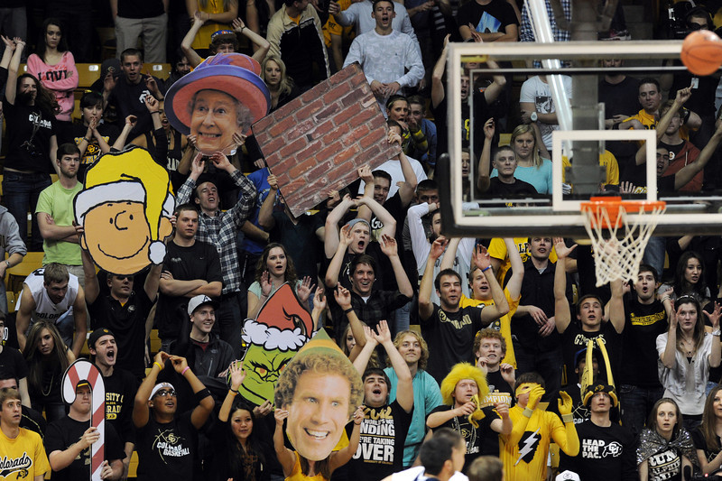 More creative faces in the CU student section during the second half of the December 21, 2012 game in Boulder.<br /> Cliff Grassmick / December 21, 2012