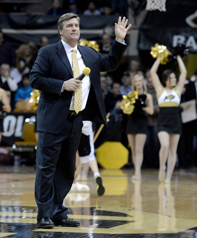 "University of Colorado head football coach Mike MacIntyre makes a statement to fans during a CU men's basketball game against Northern Arizona on Friday, Dec. 21, at the Coors Event Center on the CU campus in Boulder. For more photos of the game go to  <a href=""http://www.dailycamera.com"">http://www.dailycamera.com</a><br /> Jeremy Papasso/ Camera"