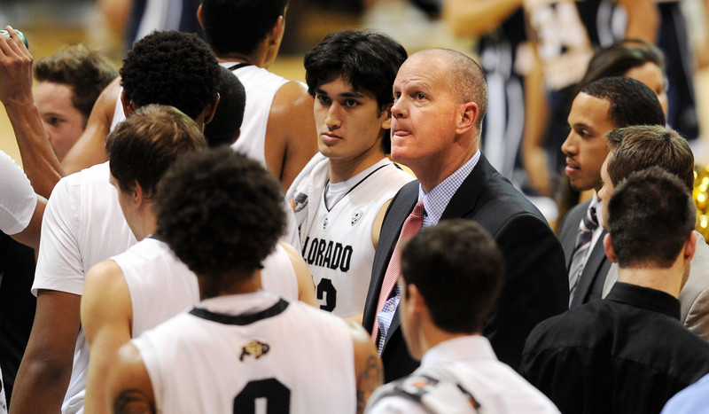 CU Coach Tad Boyle looks up to the scoreboard during the second half of the December 21, 2012 Northern Arizona game in Boulder.<br /> Cliff Grassmick / December 21, 2012
