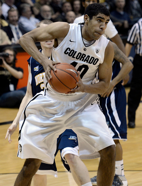 "University of Colorado's Josh Scott snags a rebound during a game against Northern Arizona on Friday, Dec. 21, at the Coors Event Center on the CU campus in Boulder. For more photos of the game go to  <a href=""http://www.dailycamera.com"">http://www.dailycamera.com</a><br /> Jeremy Papasso/ Camera"