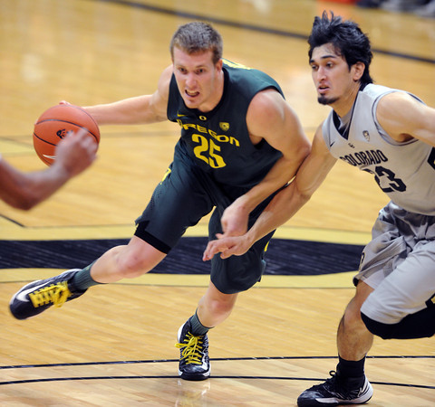 """EJ Singler of Oregon drives on Sabatino Chen during the first half of the March 7, 2013 game in Boulder.<br /> For more photos of the game, go to  <a href=""""http://www.dailycamera.com"""">http://www.dailycamera.com</a>.<br /> Cliff Grassmick / March 7, 2013"""