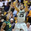 "Spencer Dinwiddie of CU shoots on Carlos Emory of Oregon during the second half of the March 7, 2013 game in Boulder.<br /> For more photos of the game, go to  <a href=""http://www.dailycamera.com"">http://www.dailycamera.com</a>.<br /> Cliff Grassmick / March 7, 2013"