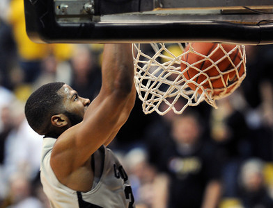 Jeremy Adams has a break away dunk during the second half of the March 7, 2013 game in Boulder. For more photos of the game, go to www.dailycamera.com. Cliff Grassmick / March 7, 2013