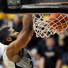 "Jeremy Adams has a break away dunk during the second half of the March 7, 2013 game in Boulder.<br /> For more photos of the game, go to  <a href=""http://www.dailycamera.com"">http://www.dailycamera.com</a>.<br /> Cliff Grassmick / March 7, 2013"