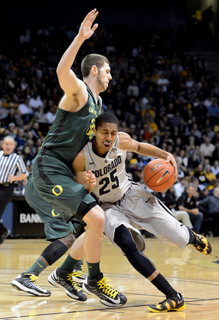 "Spenser Dinwiddie of Colorado drives on Ben Carter of Oregon during the first half of the March 7, 2013 game in Boulder.<br /> For more photos of the game, go to  <a href=""http://www.dailycamera.com"">http://www.dailycamera.com</a>.<br /> Cliff Grassmick / March 7, 2013"