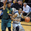 "Spencer Dinwiddie of CU drives on Carlos Emory of Oregon during the second half of the March 7, 2013 game in Boulder.<br /> For more photos of the game, go to  <a href=""http://www.dailycamera.com"">http://www.dailycamera.com</a>.<br /> Cliff Grassmick / March 7, 2013"