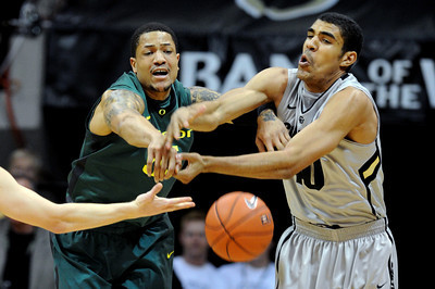 Tony Woods, left, of Oregon, and Josh Scott, of Colorado, fight for a rebound during the first half of the March 7, 2013 game in Boulder. For more photos of the game, go to www.dailycamera.com. Cliff Grassmick / March 7, 2013