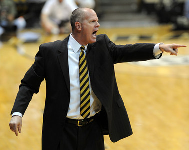 Cu Coach Tad Boyle yells instructions during the first half of the March 7, 2013 game in Boulder. For more photos of the game, go to www.dailycamera.com. Cliff Grassmick / March 7, 2013