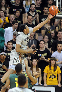 Xavier Johnson goes high to he basket against Oregon during the first half of the March 7, 2013 game in Boulder. For more photos of the game, go to www.dailycamera.com. Cliff Grassmick / March 7, 2013