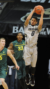 Askia Booker of CU goes high for a rebound against Oregon during the first half of the March 7, 2013 game in Boulder. For more photos of the game, go to www.dailycamera.com. Cliff Grassmick / March 7, 2013