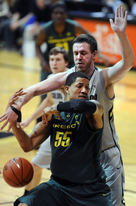 Shane Harris-Tunks knocks the ball from Tony Woods of Oregon during the first half of the March 7, 2013 game in Boulder. For more photos of the game, go to www.dailycamera.com. Cliff Grassmick / March 7, 2013