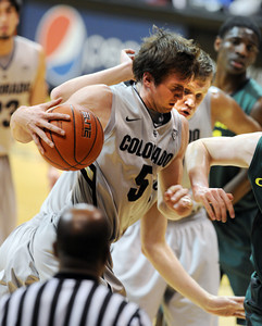 Eli Stalzer of CU swoops in for a rebound during the first half of the March 7, 2013 game in Boulder. For more photos of the game, go to www.dailycamera.com. Cliff Grassmick / March 7, 2013
