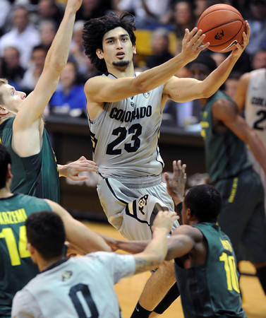 "Sabatino Chen of CU goes up for a shot against Oregon during the second half of the March 7, 2013 game in Boulder.<br /> For more photos of the game, go to  <a href=""http://www.dailycamera.com"">http://www.dailycamera.com</a>.<br /> Cliff Grassmick / March 7, 2013"