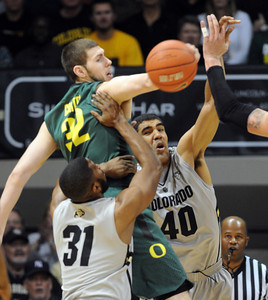 Ben Carter (32) of Oregon and Josh Scott of Colorado battle for the ball during the first half of the March 7, 2013 game in Boulder. For more photos of the game, go to www.dailycamera.com. Cliff Grassmick / March 7, 2013