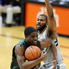 "Damyean Dotson of Oregon drives past Jeremy Adams of Colorado during the first half of the March 7, 2013 game in Boulder.<br /> For more photos of the game, go to  <a href=""http://www.dailycamera.com"">http://www.dailycamera.com</a>.<br /> Cliff Grassmick / March 7, 2013"