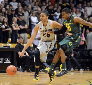 Spencer Dinwiddie of CU tries to get away from Johnathan Loyd of Oregon during the first half of the March 7, 2013 game in Boulder. For more photos of the game, go to www.dailycamera.com. Cliff Grassmick / March 7, 2013
