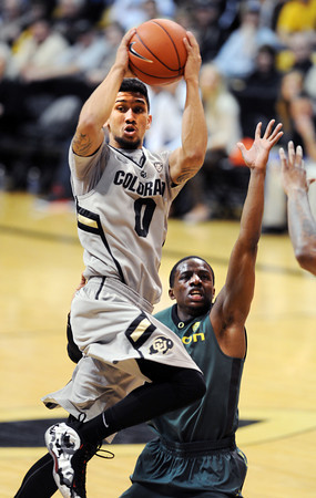 "Askia Booker of Colorado prepares to pass off past Johnathan Loyd of Oregon during the second half of the March 7, 2013 game in Boulder.<br /> For more photos of the game, go to  <a href=""http://www.dailycamera.com"">http://www.dailycamera.com</a>.<br /> Cliff Grassmick / March 7, 2013"