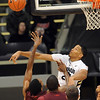 "Andre Roberson, right, of Colorado, blocks the shot of Fred Sturdivant of Texas Southern during the first half of the December 22, 2011 game in Boulder.<br /> <br /> For more photos of the game, go to  <a href=""http://www.dailycamera.com"">http://www.dailycamera.com</a>.<br /> December 22, 2011 / Cliff Grassmick"