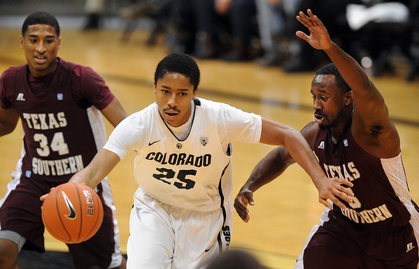 "Spencer Dinwiddie of Colorado, drives between Madarious Gibbs left, and Omar Strong both  of Texas Southern during the second half of the December 22, 2011 game in Boulder.<br /> For more photos of the game, go to  <a href=""http://www.dailycamera.com"">http://www.dailycamera.com</a>.<br /> December 22, 2011 / Cliff Grassmick"