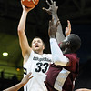 "Austin Dufault of Colorado drives to the basket over Daniel King of Texas Southern during the first half of the December 22, 2011 game in Boulder.<br /> <br /> For more photos of the game, go to  <a href=""http://www.dailycamera.com"">http://www.dailycamera.com</a>.<br /> December 22, 2011 / Cliff Grassmick"